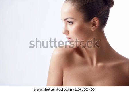 Pretty young girl in studio - stock photo