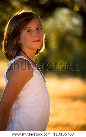 Pretty young girl in warm light - stock photo