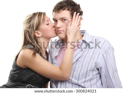 pretty young girl kissing handsome young guy - stock photo