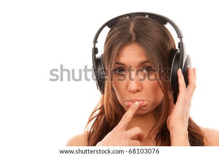 Pretty young girl listening music on her new cellular touch mp3 player in big headphones isolated on white background - stock photo