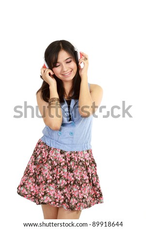 pretty young girl listening music with her headphone. in isolated over white - stock photo