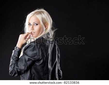Pretty young girl look at camera with desire - stock photo