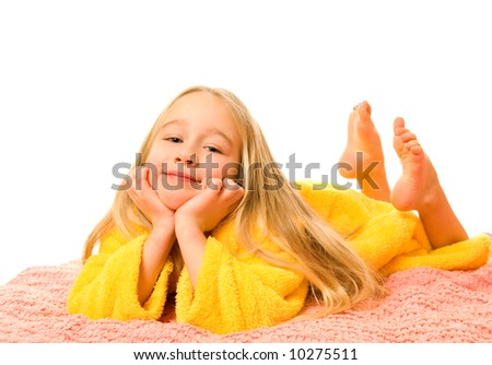 Pretty young girl lying on a bed and dreaming - stock photo