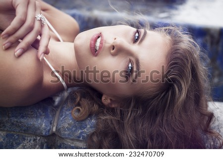 Pretty young girl lying on the back