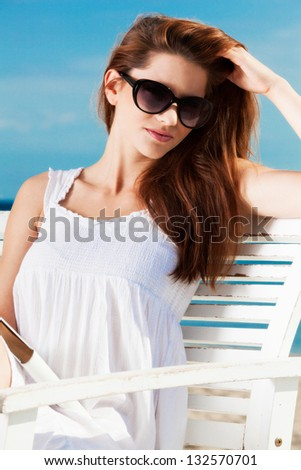 Pretty young girl lying on the beach - stock photo