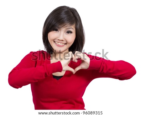 pretty young girl making heart sign - stock photo