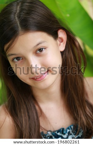 Pretty young girl outdoors. - stock photo