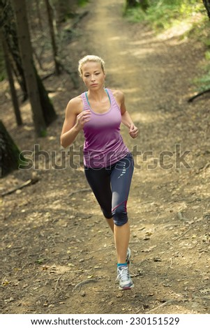 Pretty young girl runner in the forest.  Running woman. Female Runner Jogging during Outdoor Workout in a Nature. Beautiful fit Girl. Fitness model outdoors. Weight Loss. Healthy lifestyle.  - stock photo