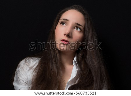 Pretty young girl show emotions isolated on black