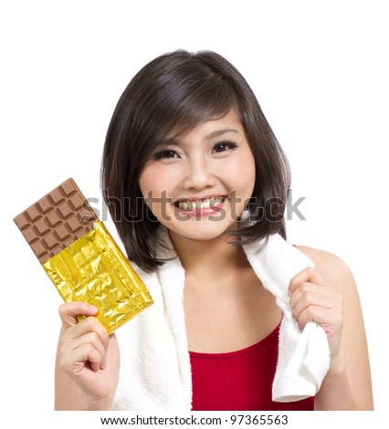 pretty young girl showing chocolate after exercise - stock photo