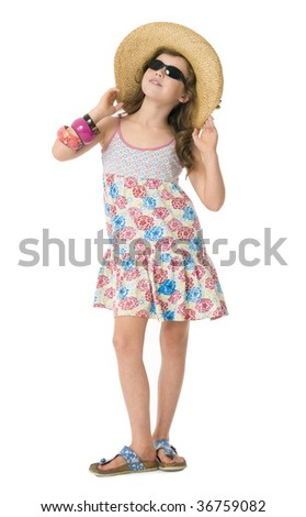 Pretty young girl standing dressed for summer holiday