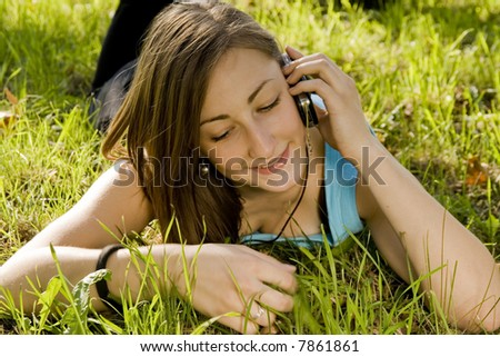 pretty young girl talking on the cellphone - stock photo
