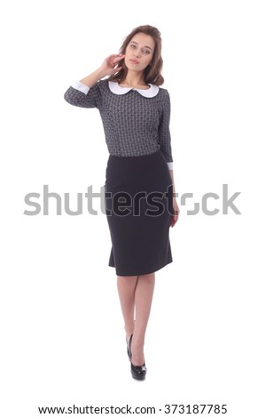 pretty young girl wearing black formal skirt and grey jacket
