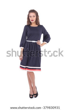 pretty young girl wearing blue dress with the white and red stripes - stock photo
