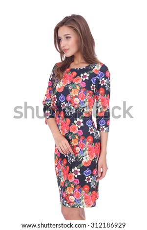 pretty young girl wearing floral printed dress - stock photo