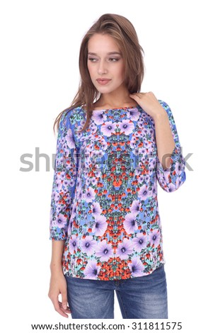 pretty young girl wearing jeans and floral printed top - stock photo