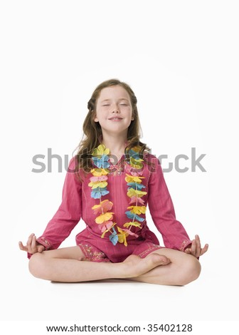 Pretty, young girl wearing kaftan in relaxed yoga pose - stock photo