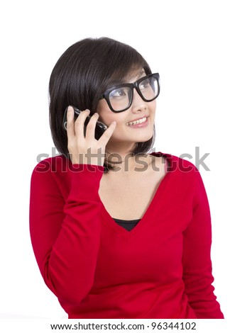 pretty young girl wearing nerd glasses talking on the phone