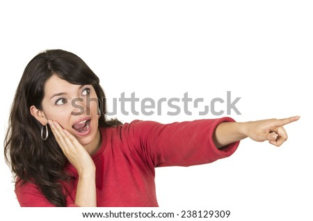pretty young girl wearing red top pointing with finger looking unbelieving isolated on white - stock photo