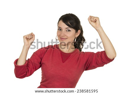 pretty young girl wearing red top posing with fists up celebrating isolated on white