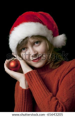 Pretty young girl wearing santa claus hat
