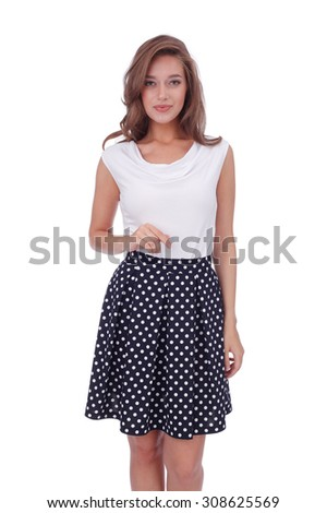 pretty young girl wearing short polka dot skirt - stock photo