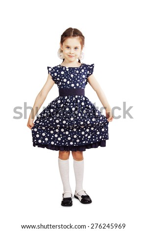 Pretty young girl wearing the dark blue dress - stock photo