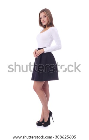 pretty young girl wearing white top and black skirt - stock photo