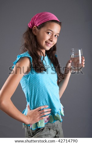 Pretty young girl with a glass of water - stock photo