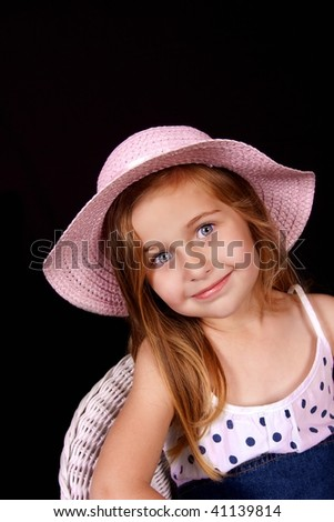 Pretty young girl with blue eyes and pink hat