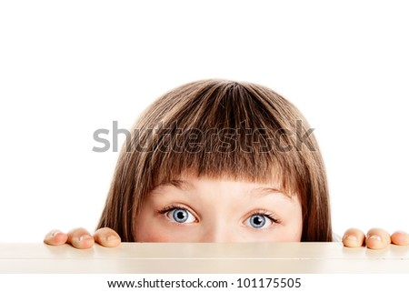 Pretty young girl with blue eyes, looking surprised - stock photo