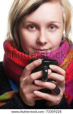 Pretty young girl with cup in hands, on white - stock photo
