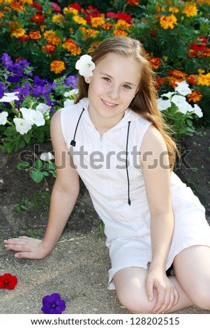 pretty young girl with flowers outdoors, spring time