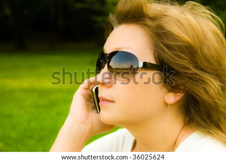 pretty young girl with mobile phone - stock photo