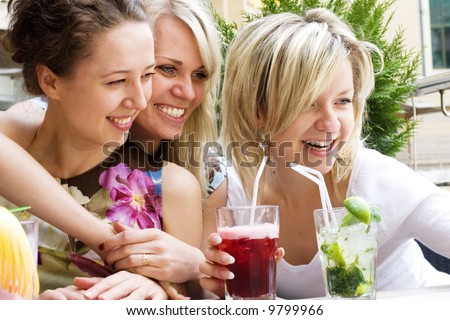 Pretty Young Girls Having Fun At The Cafe - stock photo