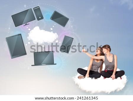 Pretty young girls sitting on cloud enjoying cloud network service - stock photo