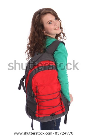 Pretty young high school teenager girl, with long brown hair wearing green jumper and red school backpack with big happy smile. Studio shot against white background.