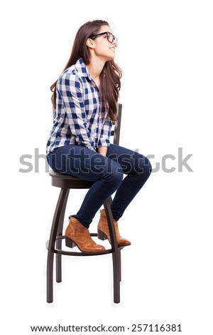 Pretty young Hispanic woman wearing glasses and looking towards copy space - stock photo