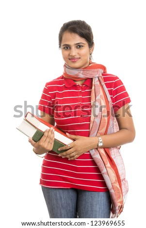 pretty young Indian girl student posing with books. - stock photo
