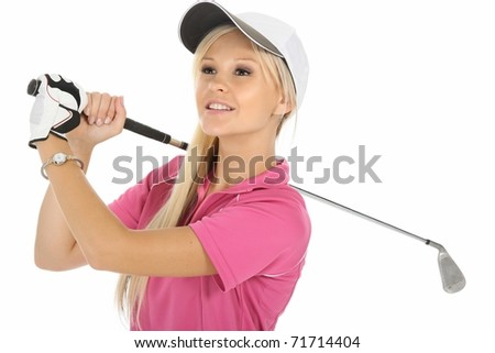 Pretty young lady golfer looking into the distance - stock photo