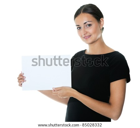 Pretty young lady holding a blank billboard - stock photo