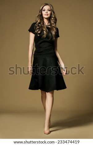 Pretty young lady in a fashion pose - stock photo