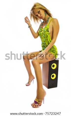 Pretty young lady listening to music isolated on white background - stock photo