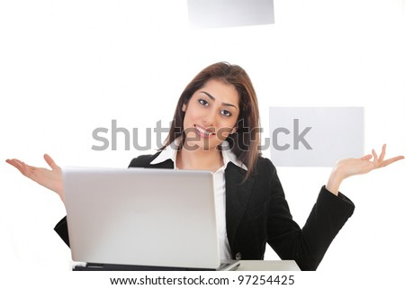 Pretty young lady on laptop making hand gesture - stock photo