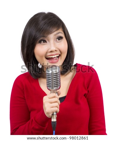 Pretty Young Lady Singing Using Vintage Microphone