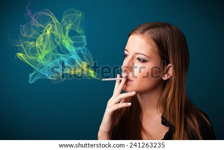 Pretty young lady smoking cigarette with colorful smoke - stock photo