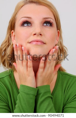pretty young lady with beautiful makeup, long eyelashes and manicured nails