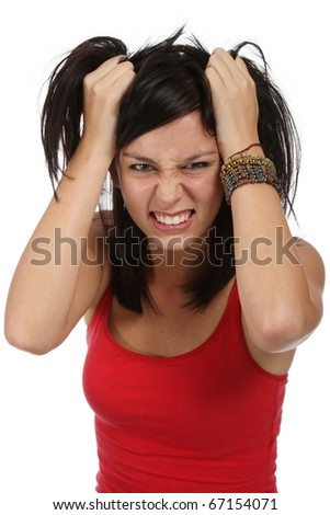 Pretty young lady with frustrated look and hands in her hair - stock photo