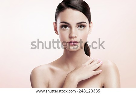 Pretty young lady with professional make-up, skin care concept / photoset of attractive brunette girl on beige background  - stock photo