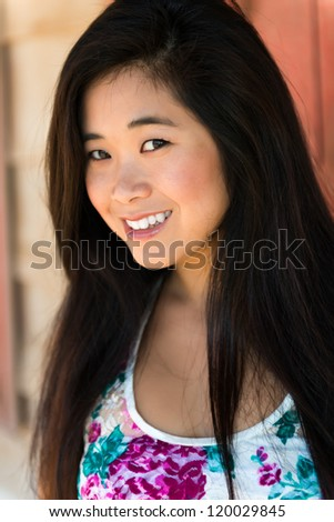 Pretty young Laotian woman in a flower print blouse - stock photo